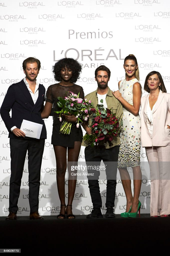 Model Aya Gueye (2L) and designer Juan Vidal (C) receive the L'Oreal Paris Award from L'Oreal Paris Brand General Manager Gregory Recoing (L), model Laura Sanchez (2R) and Mercedes-Benz Fashion Week Madrid director Charo Izquierdo (R) during the Mercedes-Benz Fashion Week Madrid Spring/Summer 2018 at Ifema on September 18, 2017 in Madrid, Spain.