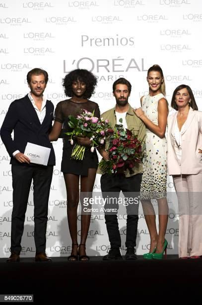 Model Aya Gueye and designer Juan Vidal receive the L'Oreal Paris Award from L'Oreal Paris Brand General Manager Gregory Recoing model Laura Sanchez...