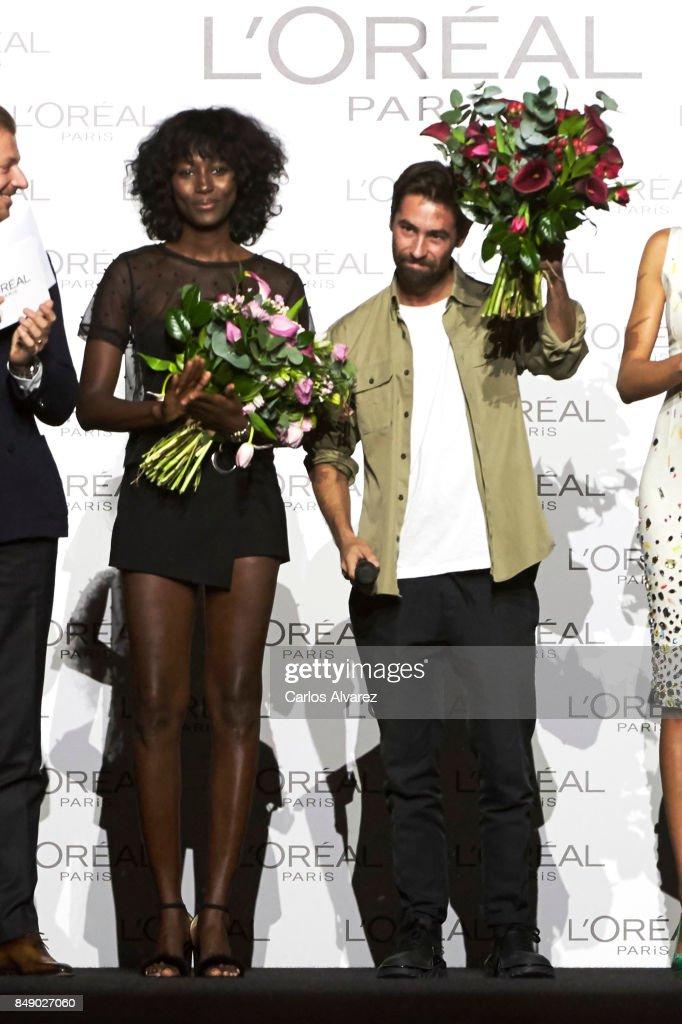 Model Aya Gueye (L) and designer Juan Vidal (R) receive the L'Oreal Paris Award during the Mercedes-Benz Fashion Week Madrid Spring/Summer 2018 at Ifema on September 18, 2017 in Madrid, Spain.
