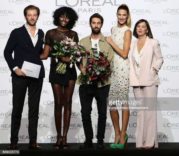 Model Aya Gueye and designer Juan Vidal receive the L'Oreal Paris Award from L'Oreal Paris Brand General Manager Gregory Recoing model Laura Sanchez...