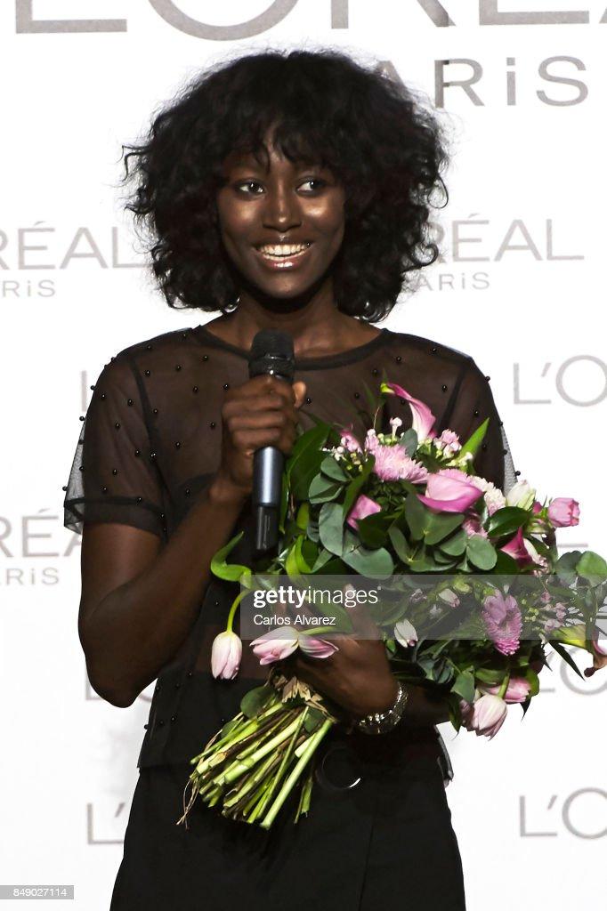 Model Aya Gueye (L) receives the L'Oreal Paris Award during the Mercedes-Benz Fashion Week Madrid Spring/Summer 2018 at Ifema on September 18, 2017 in Madrid, Spain.