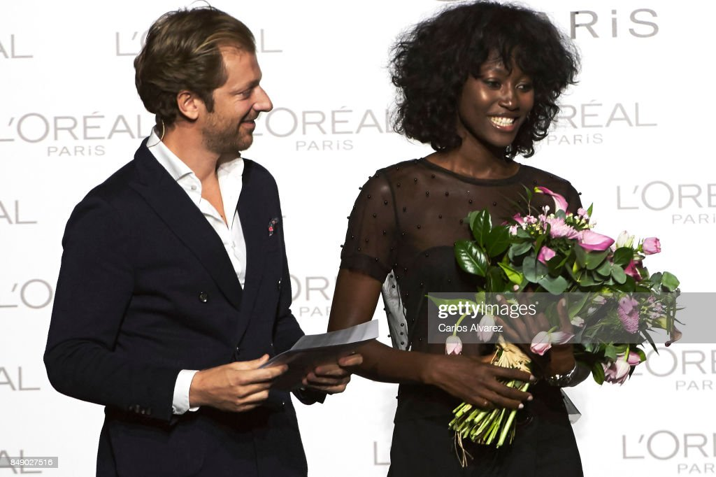 Model Aya Gueye receives the L'Oreal Paris Award from L'Oreal Paris Brand General Manager Gregory Recoing during the Mercedes-Benz Fashion Week Madrid Spring/Summer 2018 at Ifema on September 18, 2017 in Madrid, Spain.