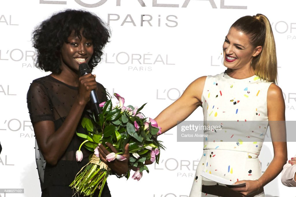 Model Aya Gueye (L) receives the L'Oreal Paris Award from Spanish model Laura Sanchez (R) during the Mercedes-Benz Fashion Week Madrid Spring/Summer 2018 at Ifema on September 18, 2017 in Madrid, Spain.