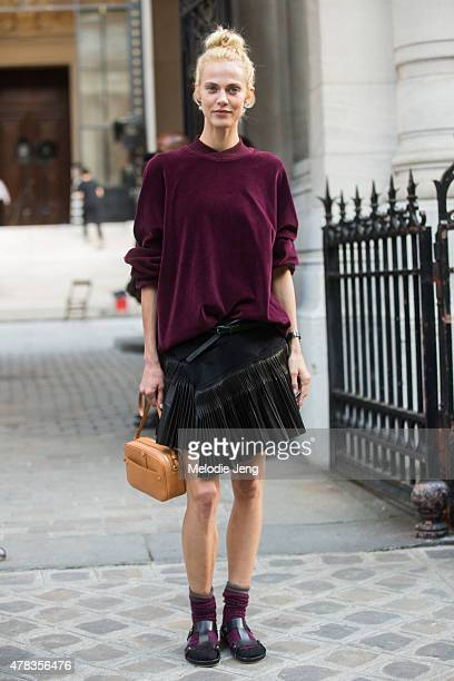 Model Aymeline Valade exits the Haider Ackermann show in a Haider Ackermann outfit on June 24 2015 in Paris France