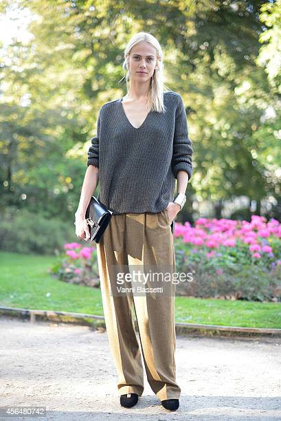 Model Aymeline Valade poses wearing an Hermes total look on the streets of Paris during Paris Fashion Week on October 1 2014 in Paris France