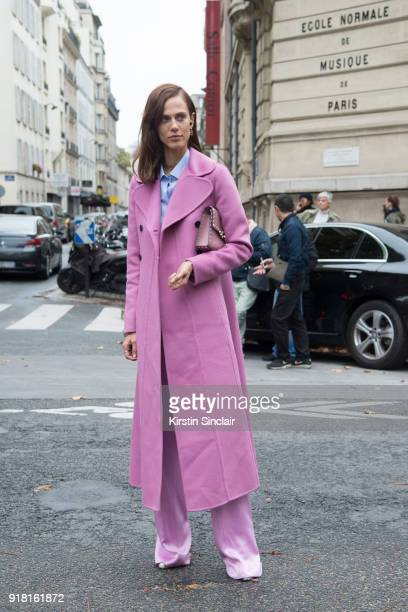 Model Aymeline Valade wears a Valentino coat, bag and trousers day 6 of Paris Womens Fashion Week Spring/Summer 2018, on October 1, 2017 in London,...