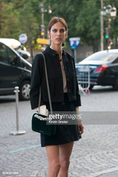 Model Aymeline Valade wears all Miu Miu and Charlotte Chesnais Earrings day 1 of Paris Haute Couture Fashion Week Autumn/Winter 2017 on July 2 2017...