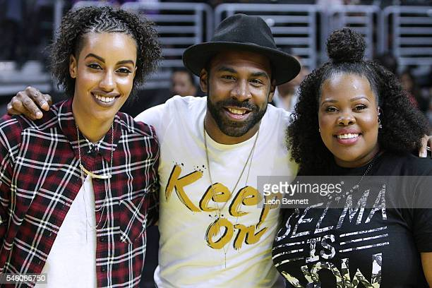 Model AzMarie Livingston Music artists Major and Amber Riley attend the Washington Mystics vs the Los Angeles Sparks during WNBA basketball game at...