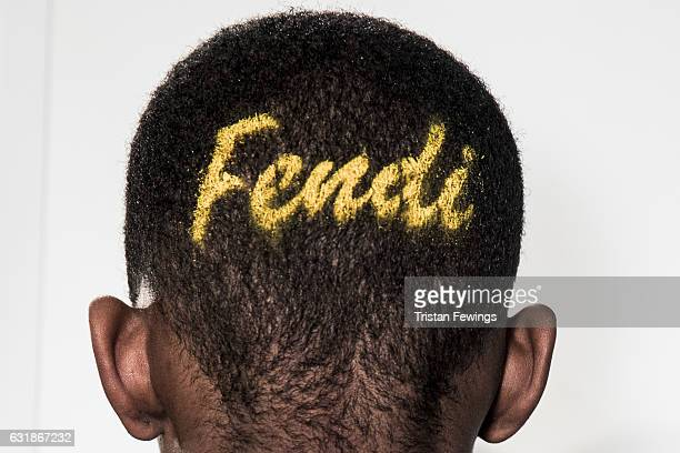 A model back detail is seen backstage ahead of the Fendi show during Milan Men's Fashion Week Fall/Winter 2017/18 on January 16 2017 in Milan Italy