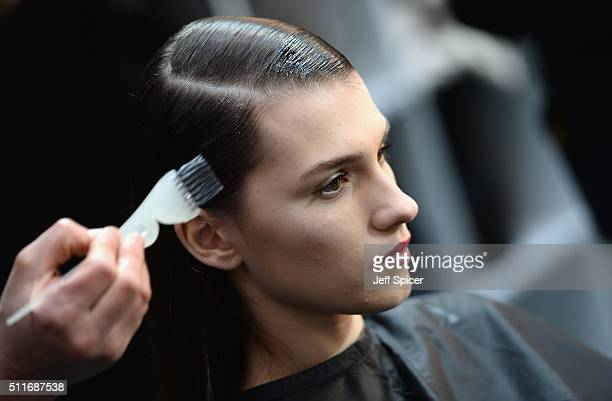 A model backstage ahead of the Antonio Berardi show during London Fashion Week Autumn/Winter 2016/17 at Brewer Street Car Park on February 22 2016 in...