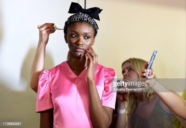 A model backstage ahead of the Ashley Williams show during London Fashion Week February 2019 on February 15 2019 in London England