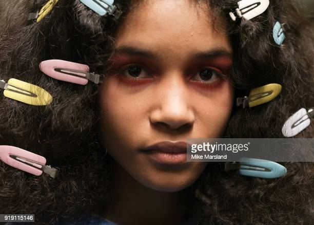 Model backstage ahead of the Ashley Williams show during London Fashion Week February 2018 at University of Westminster on February 16, 2018 in...