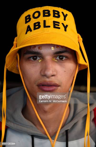 A model backstage ahead of the Bobby Abley show during the London Fashion Week Men's June 2017 collections on June 12 2017 in London England