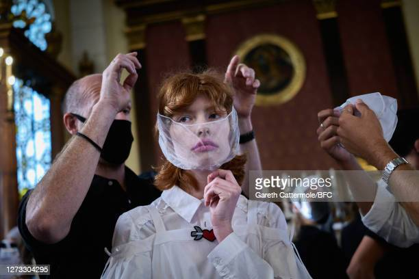 Model backstage ahead of the Bora Aksu show during LFW September 2020 at The Waldorf London on September 18, 2020 in London, England.
