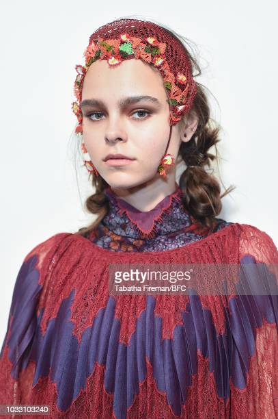 A model backstage ahead of the Bora Aksu show during London Fashion Week September 2018 at The BFC Show Space on September 14 2018 in London England