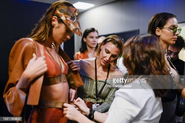A model backstage ahead of the Ceren Ocak show during the MercedesBenz Istanbul Fashion Week at Zorlu Performance Hall on September 11 2018 in...