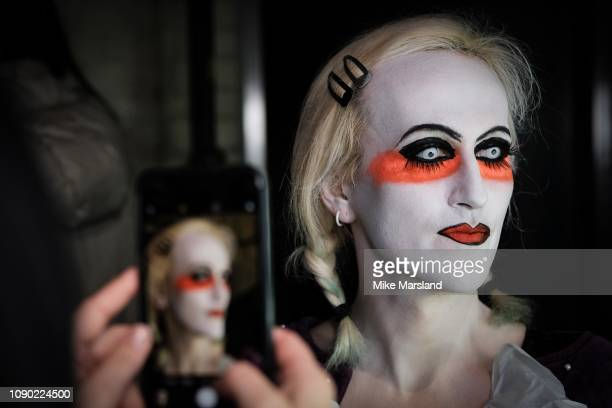 A model backstage ahead of the Charles Jeffrey Loverboy show during London Fashion Week Men's January 2019 at the Wapping Hydraulic Power Station on...