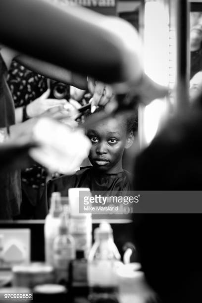 A model backstage ahead of the Christopher Raeburn show during London Fashion Week Men's June 2018 at the BFC Show Space on June 10 2018 in London...