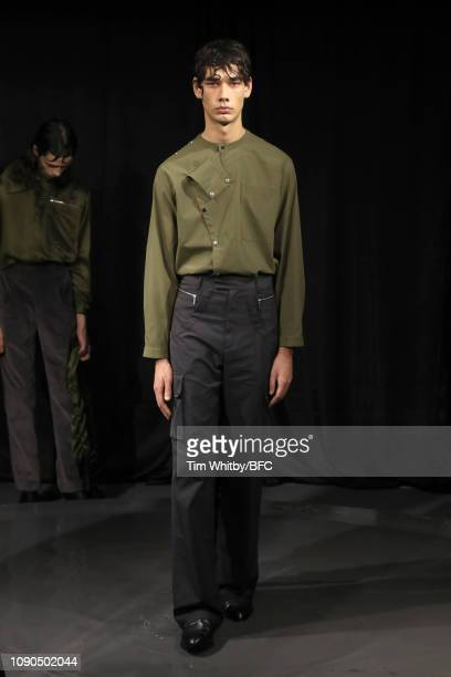 Model backstage ahead of the DANSHAN show presentation London Fashion Week Men's January 2019 at the Sarabande Foundation on January 06, 2019 in...