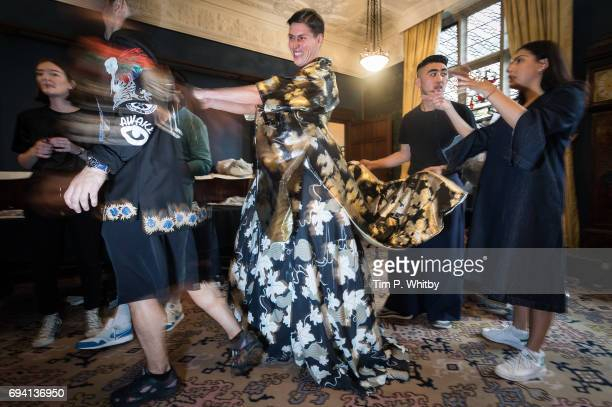A model backstage ahead of the Edward Crutchley show during the London Fashion Week Men's June 2017 collections at Ironmongers Hall on June 9 2017 in...