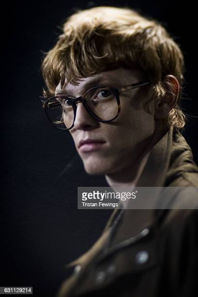 A model backstage ahead of the ETautz show during London Fashion Week Men's January 2017 collections at BFC Backstage Space on January 7 2017 in...