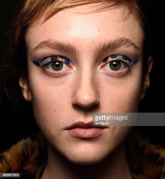 A model backstage ahead of the Eudon Choi show during London Fashion Week Fall/Winter 2015/16 at Somerset House on February 20 2015 in London England
