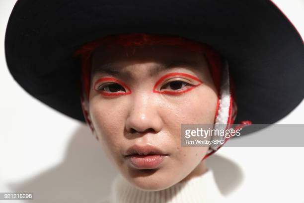 A model backstage ahead of the Eudon Choi show during London Fashion Week February 2018 at BFC Show Space on February 20 2018 in London England