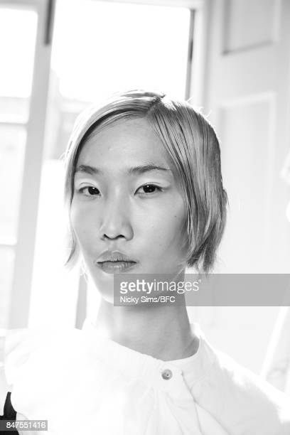 A model backstage ahead of the HAIZENWANG presentation during London Fashion Week September 2017 on September 15 2017 in London England