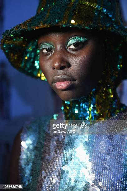 A model backstage ahead of the Halpern show during London Fashion Week September 2018 at Soho East St Giles House on September 15 2018 in London...