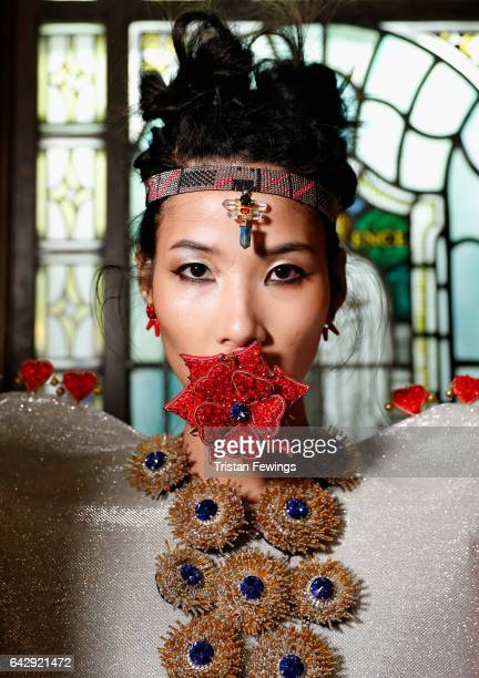 A model backstage ahead of the House Of Mea show during the London Fashion Week February 2017 collections on February 19 2017 in London England