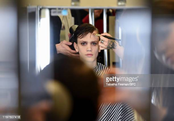 Model backstage ahead of the John Lawrence Sullivan show during London Fashion Week Men's January 2020 on January 04, 2020 in London, England.
