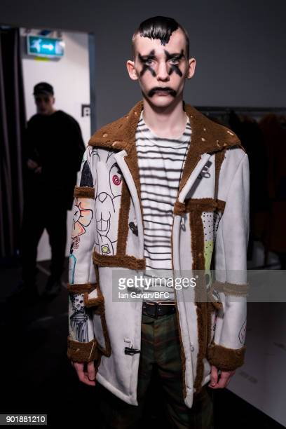 A model backstage ahead of the Liam Hodges show during London Fashion Week Men's January 2018 at BFC Show Space on January 6 2018 in London England