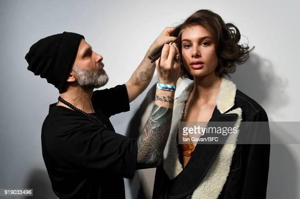 Model backstage ahead of the Marta Jakubowski show during London Fashion Week February 2018 at BFC Show Space on February 16, 2018 in London, England.