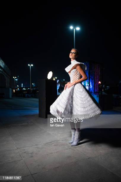 A model backstage ahead of the Michael Cinco show during the FFWD October Edition 2019 at the Dubai Design District on October 31 2019 in Dubai...