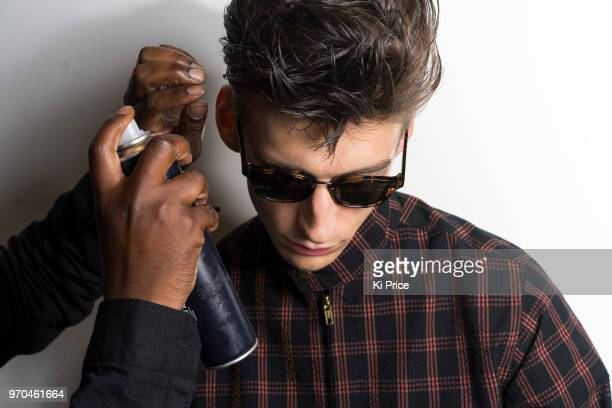 A model backstage ahead of the Oliver Spencer show during London Fashion Week Men's June 2018 at the BFC Show Space on June 9 2018 in London England
