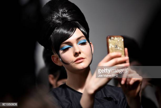 Model backstage ahead of the On Off Presents show during London Fashion Week February 2018 at BFC Show Space on February 20, 2018 in London, England.