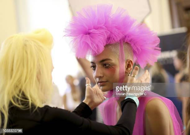 A model backstage ahead of the Pam Hogg Show during London Fashion Week September 2018 at the Freemasons Hall on September 14 2018 in London England