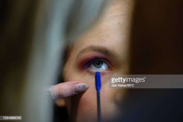 A model backstage ahead of the Paul Costelloe presentation during London Fashion Week September 2018 at The BFC Show Space on September 17 2018 in...