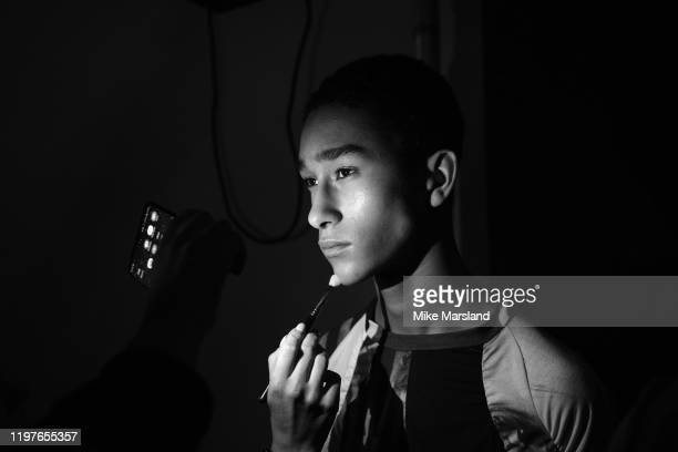 A model backstage ahead of the Per Götesson show during London Fashion Week Men's January 2020 at the BFC Show Space on January 05 2020 in London...