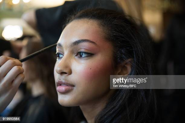 A model backstage ahead of the Roberta Einer presentation during London Fashion Week February 2018 at The Law Society on February 18 2018 in London...