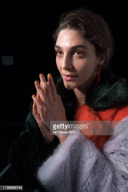 Model backstage ahead of the Roberta Einer show during London Fashion Week February 2019 at the BFC Show Space on February 19, 2019 in London,...