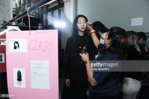 A model backstage ahead of the steventai presentation during London Fashion Week February 2018 at British Foreign and Commonwealth Office on February...