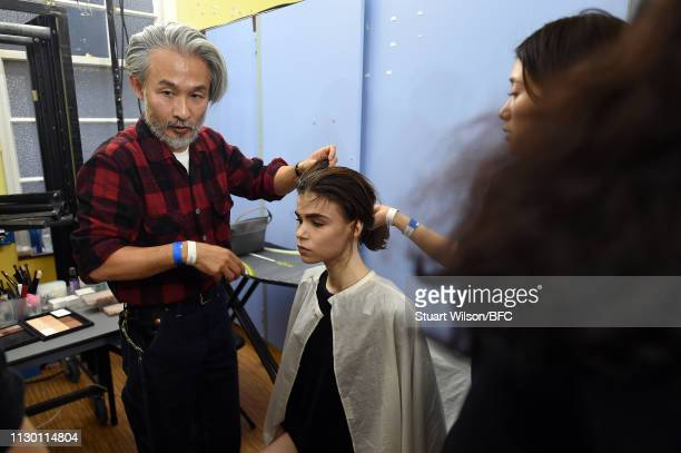 A model backstage ahead of the TOGA show during London Fashion Week February 2019 at the Seymour Leisure Centre on February 16 2019 in London England