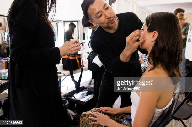 A model backstage ahead of the TOGA show during London Fashion Week September 2019 at RIBA on September 14 2019 in London England