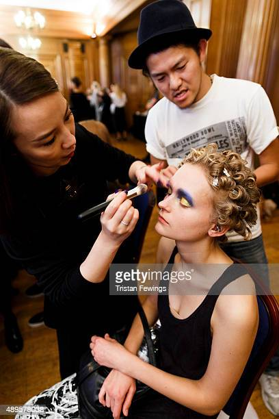 A model backstage ahead of the Toga show during London Fashion Week Spring/Summer 2016 on September 22 2015 in London England