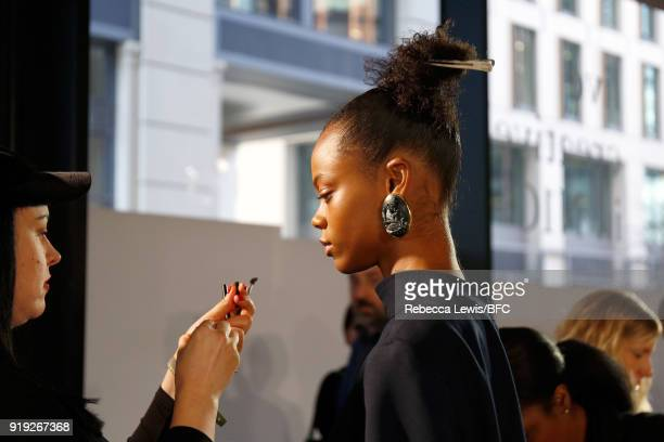 A model backstage ahead of the Toga show during London Fashion Week February 2018 on February 17 2018 in London England