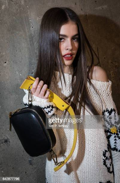 A model backstage ahead of the Topshop Unique show during the London Fashion Week February 2017 collections at Tate Modern on February 19 2017 in...