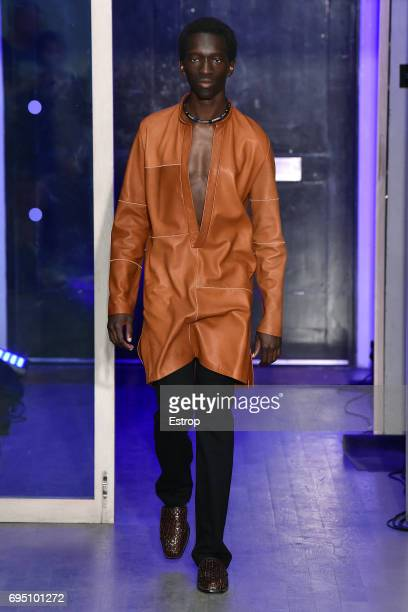 A model backstage ahead of the WALES BONNER show during the London Fashion Week Men's June 2017 collections on June 10 2017 in London England