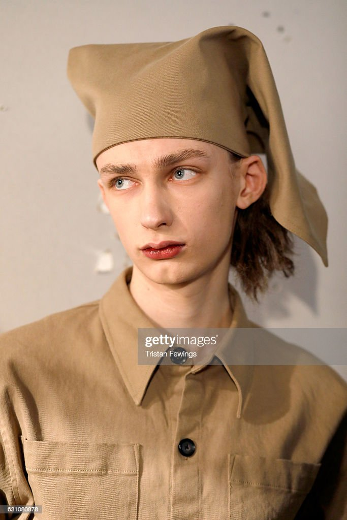 A model backstage ahead of the Xander Zhou show during London Fashion Week Men's January 2017 collections at BFC Show Space on January 6, 2017 in London, England.