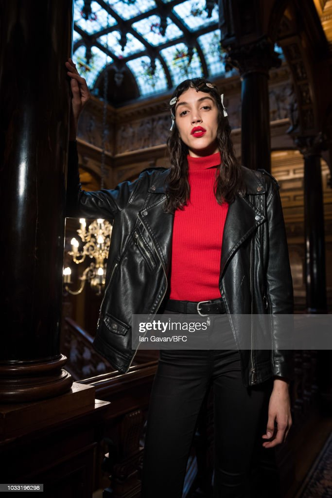 A model backstage ahead of the XU ZHI presentation during London Fashion Week September 2018 at 2 Temple Place on September 14, 2018 in London, England.